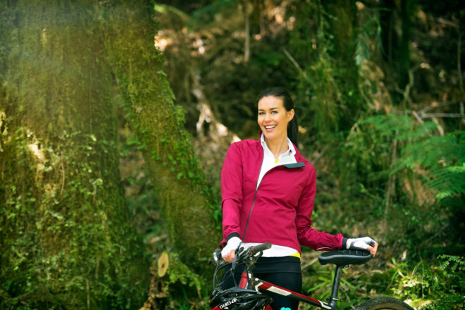 Model Megan Gale cycling New Zealand's Timber Trail.