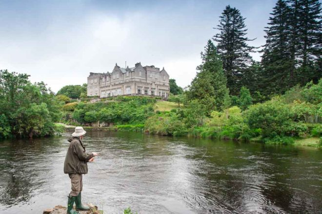 Fly fishing in front of a castle in Ireland